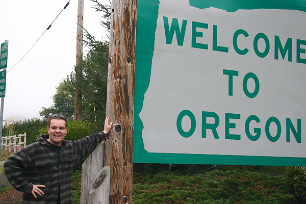 Matt Carroll with Oregon sign