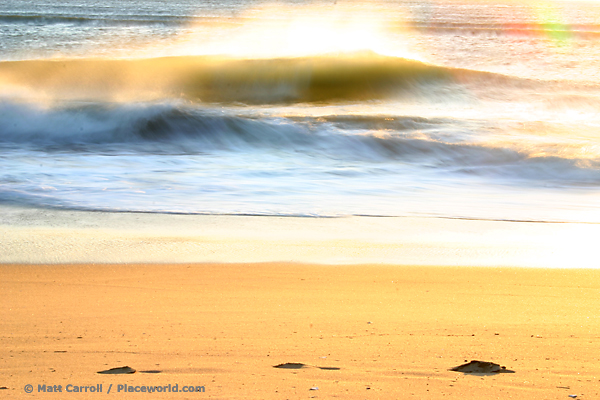 breaking ocean wave with offshore winds and glowing sunshine