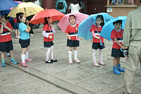 Students with colorful umbrellas