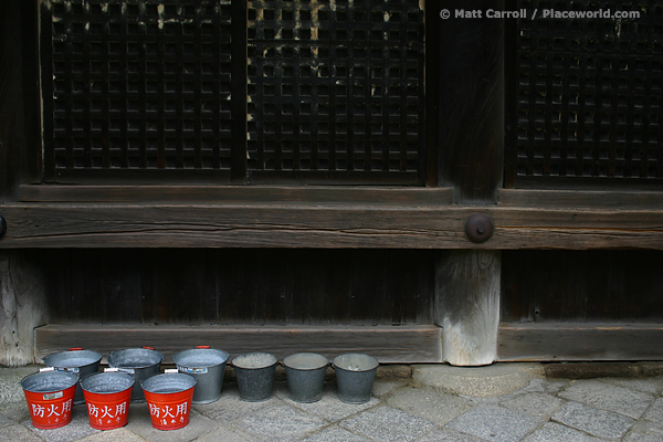 Red fire buckets in Kyoto, Japan