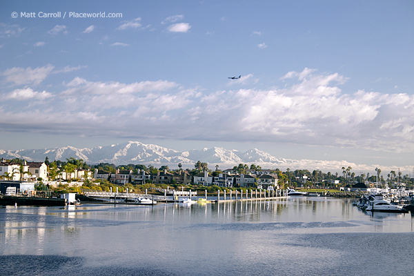 Marina Pacifica with backdrop of snow-covered San Gabriel Mountains
