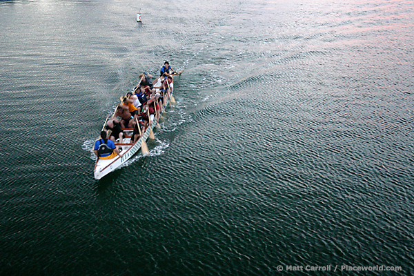15 people paddling a dragon boat through Alamitos Bay - photographer Matt Carroll